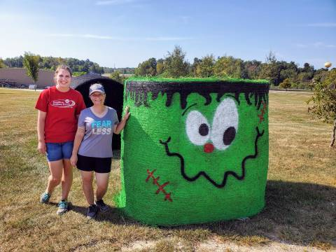 "Amanda and Alison with ""Frankenstraw"" hay bale"