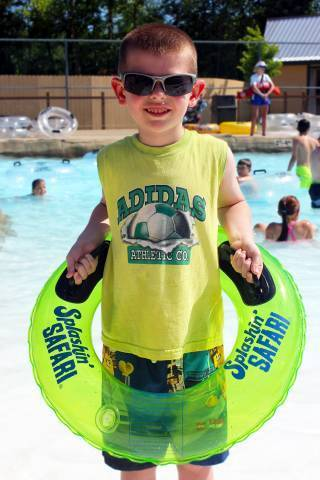 Boy with New Green Inner Tube