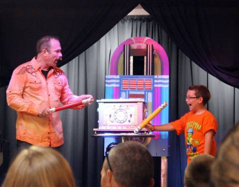 Magic Show: Don and Boy with Giant Pencils