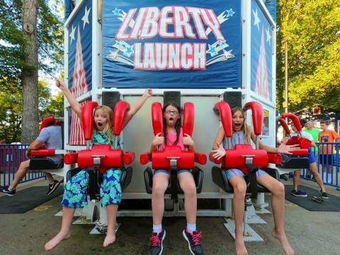 Three young girls making silly faces on Liberty Launch