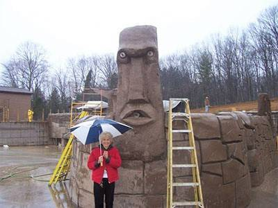 Mrs. Koch in front of tiki head