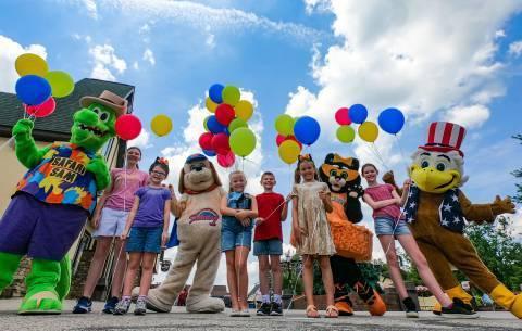 Kids and Mascots Celebrating Kids World