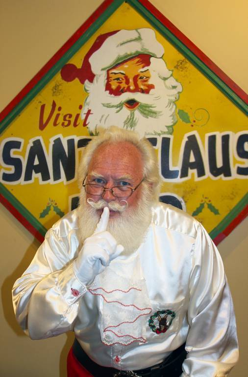 Santa with Santa Claus Land sign