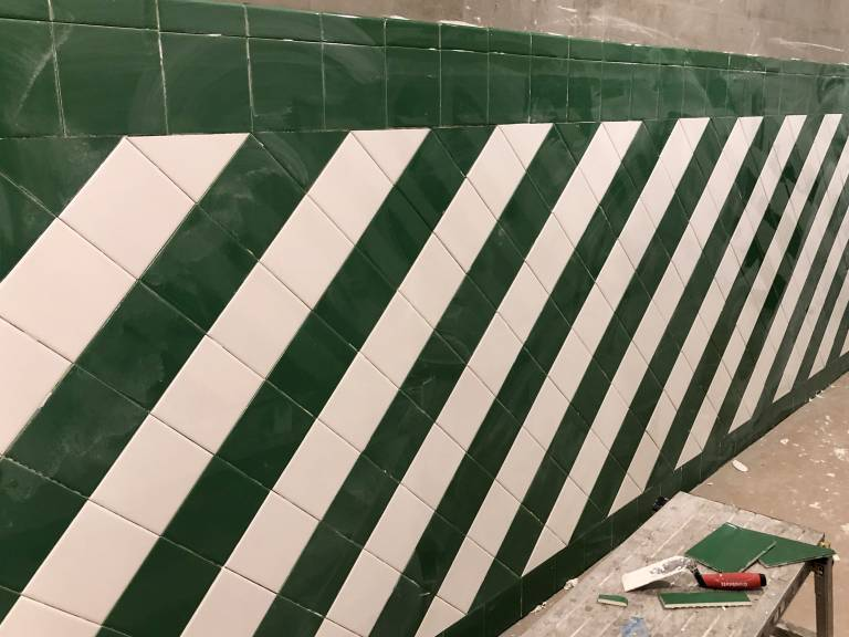Green and white tiling in restrooms
